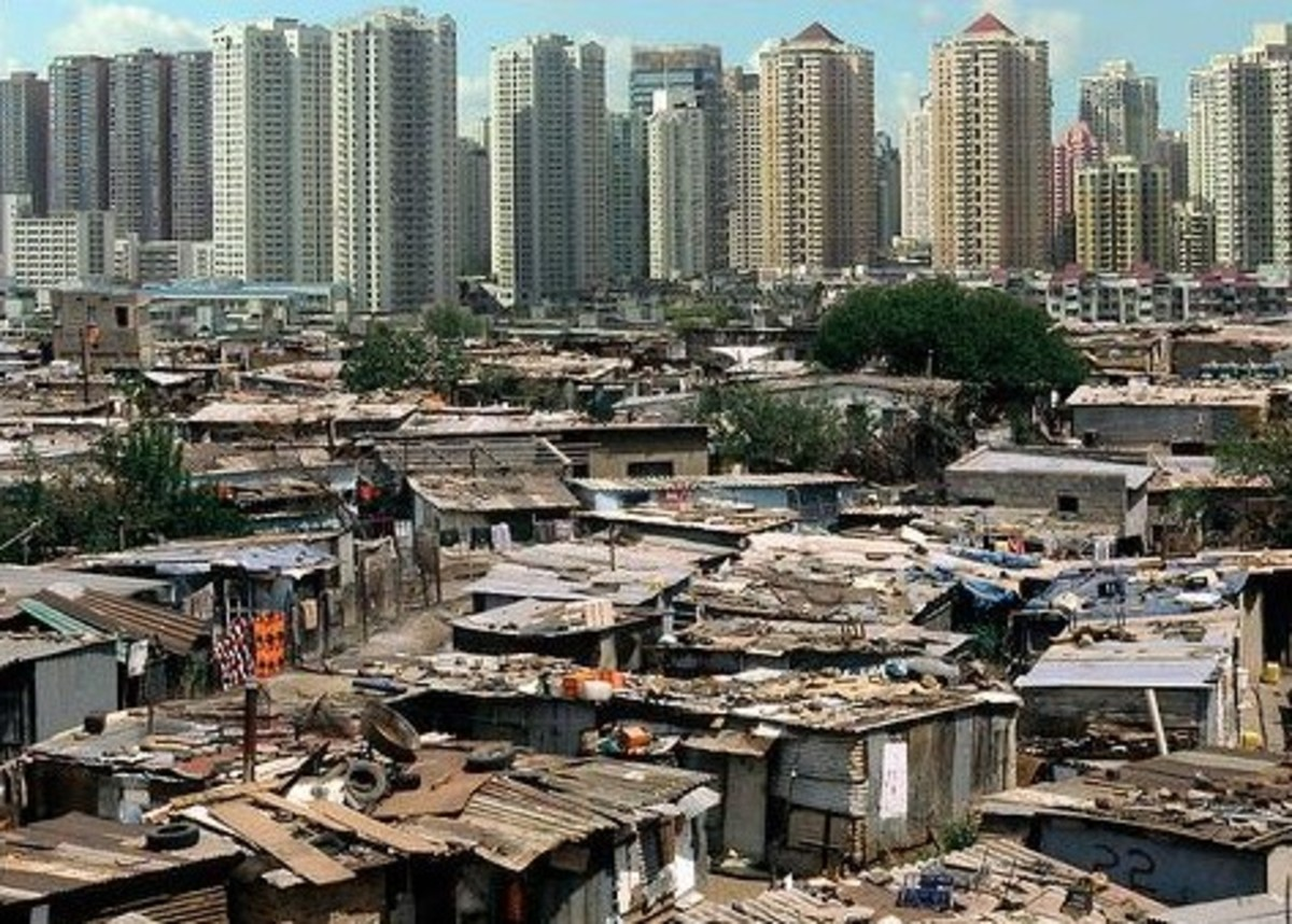 The disparity between the rich and poor in India.  All that's missing is a 50 meter wall to separate the two...