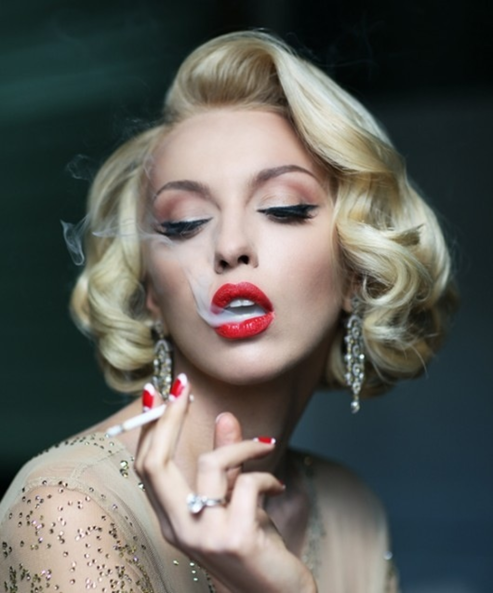 I love this picture and not to mention the hair! There are not as many things you can do with short hair like you can long. I believe this goes great with Black Tie Affair, New Years, Old Hollywood, Classy and Elegant, Everything Vintage and Chic!