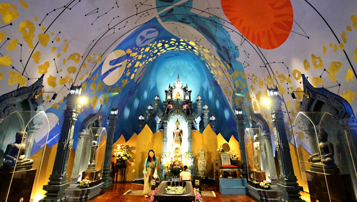 Ancient Buddha statues line the sides, and relics and a shrine are the focal point of this room - all under the vault of the cosmos, and all within the body of the Elephant