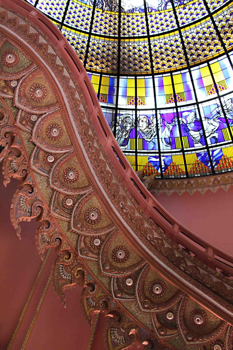 One of the flamboyant staircases and the domed ceiling beyond