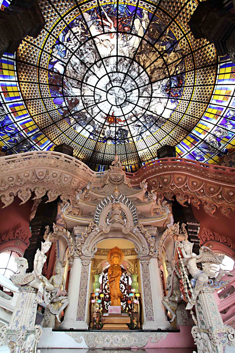 Inside the pedestal. The statue of Guanyin and the two staircases to either side. Above is the stained glass ceiling
