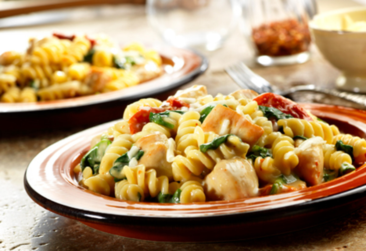 Pasta and chicken with spinach and tomatoes. Hold the seasoning!