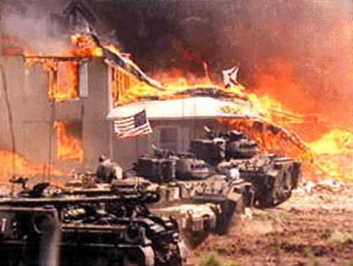 "Officials in their tanks, watching the fire that broke out on the last day which earned the battle title, ""The Waco Massacre."""
