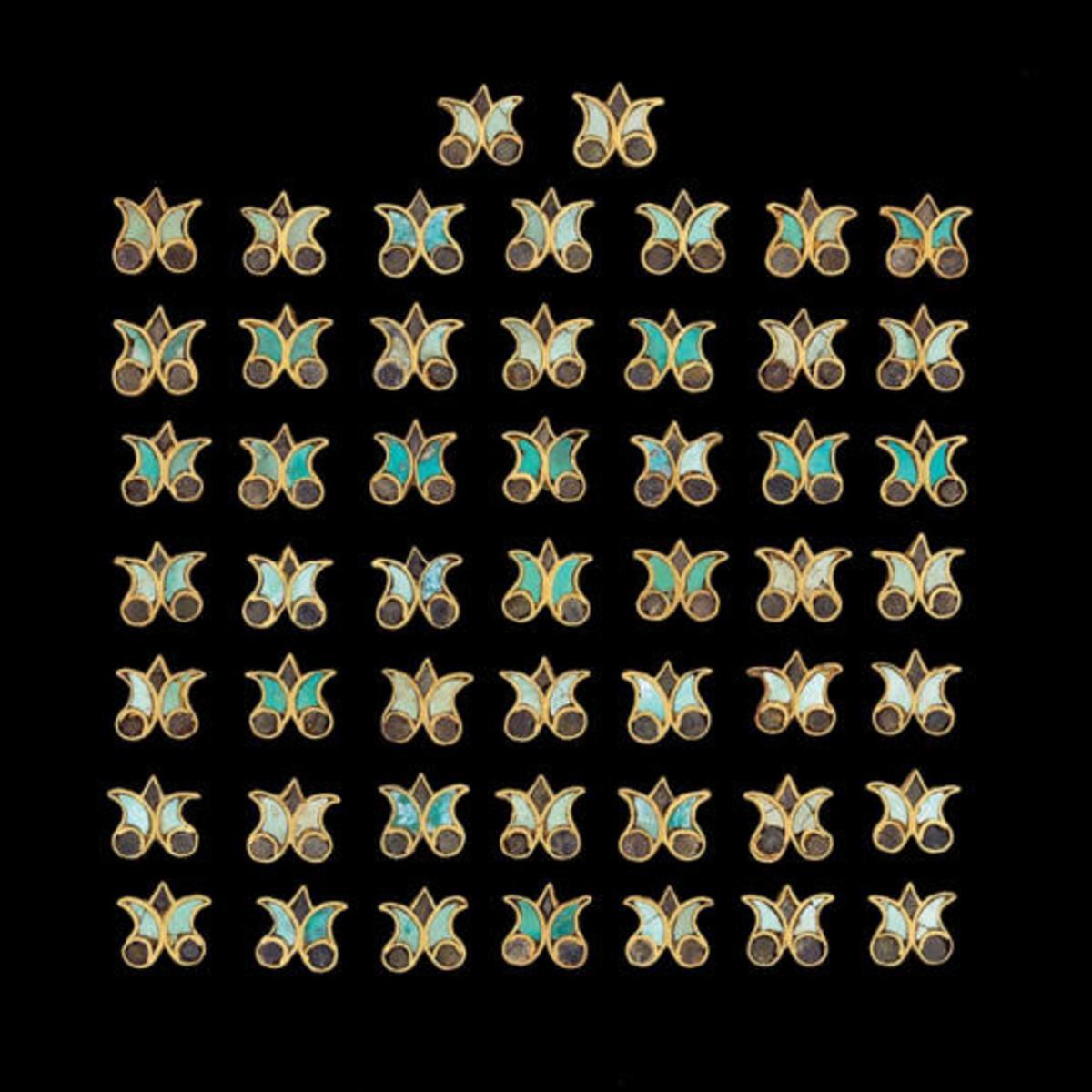 Appliqués in the shape of lotuses, 1st century CE. Image credit: Metropolitan Museum