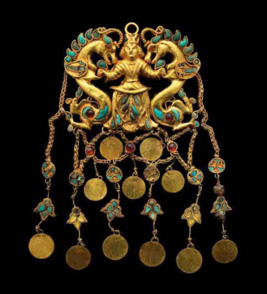 Headdress ornament. Tillya Tepe Tomb II, first century A.D. Gold with turquoise, garnet, lapis lazuli, carnelian and pearls 12.5 x 6.5 cm (5 x 2–5/8 in.) Image credit: Metropolitan Museum