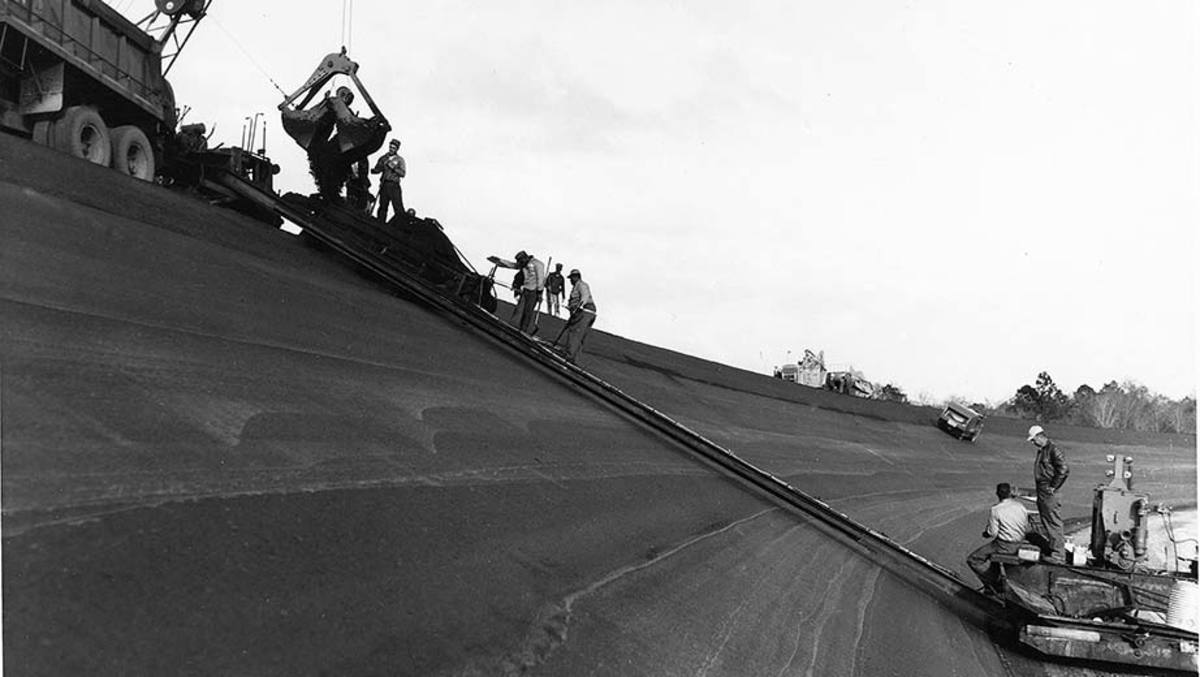 Paving the high banks of Daytona International Speedway circa 1958.
