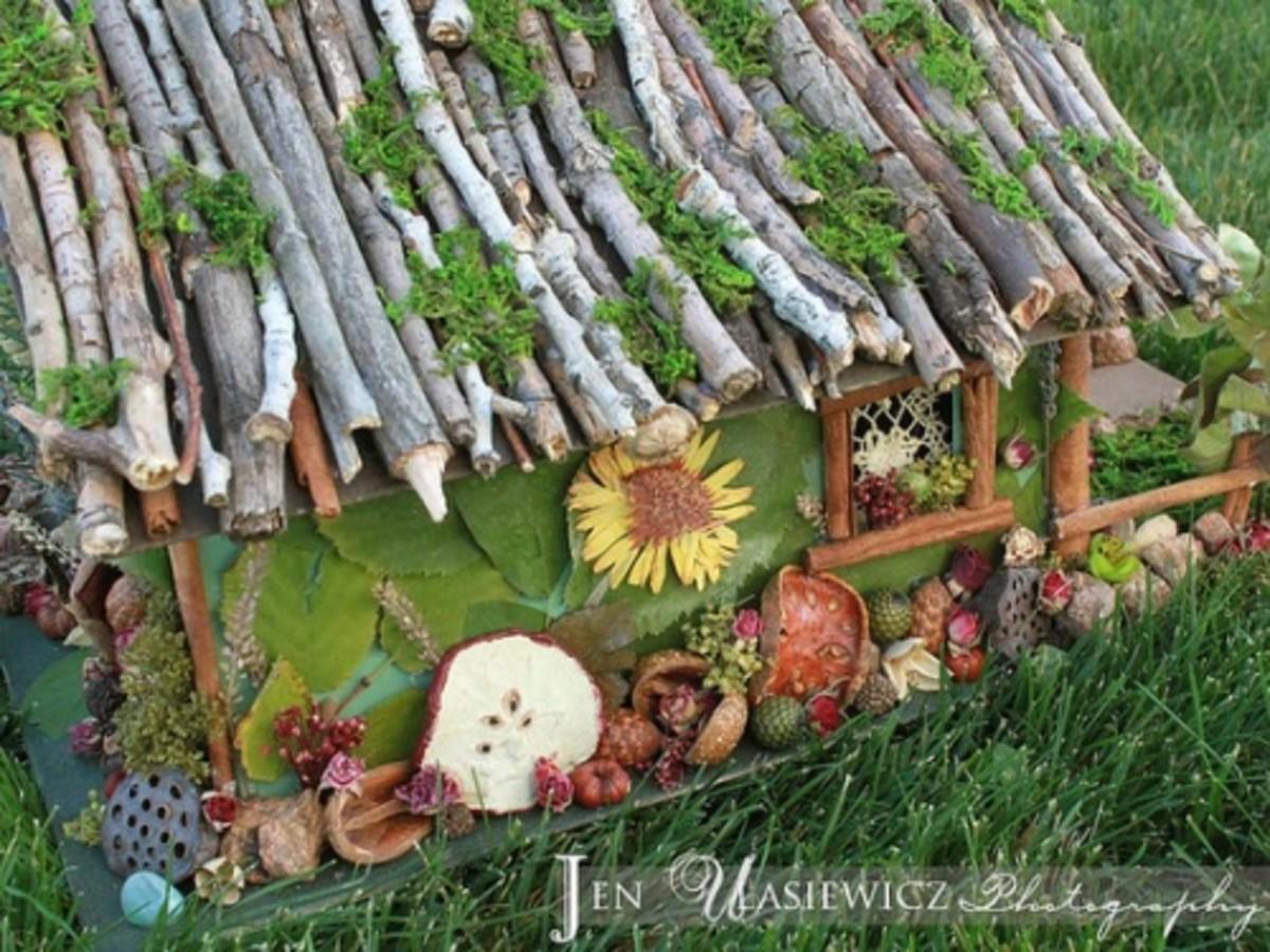 I found this quaint homemade Fairy Garden house on flickr