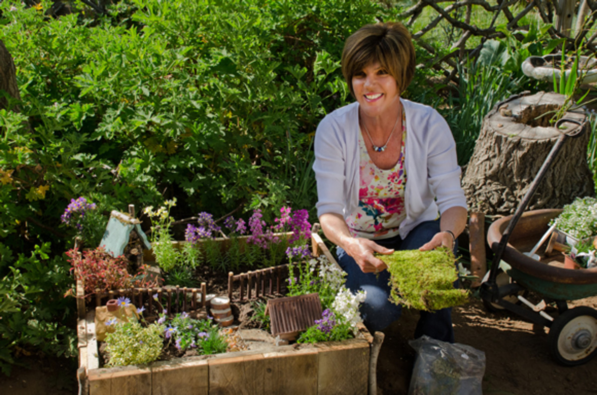 The woman's size gives us some idea of how small a Fairy Garden is.