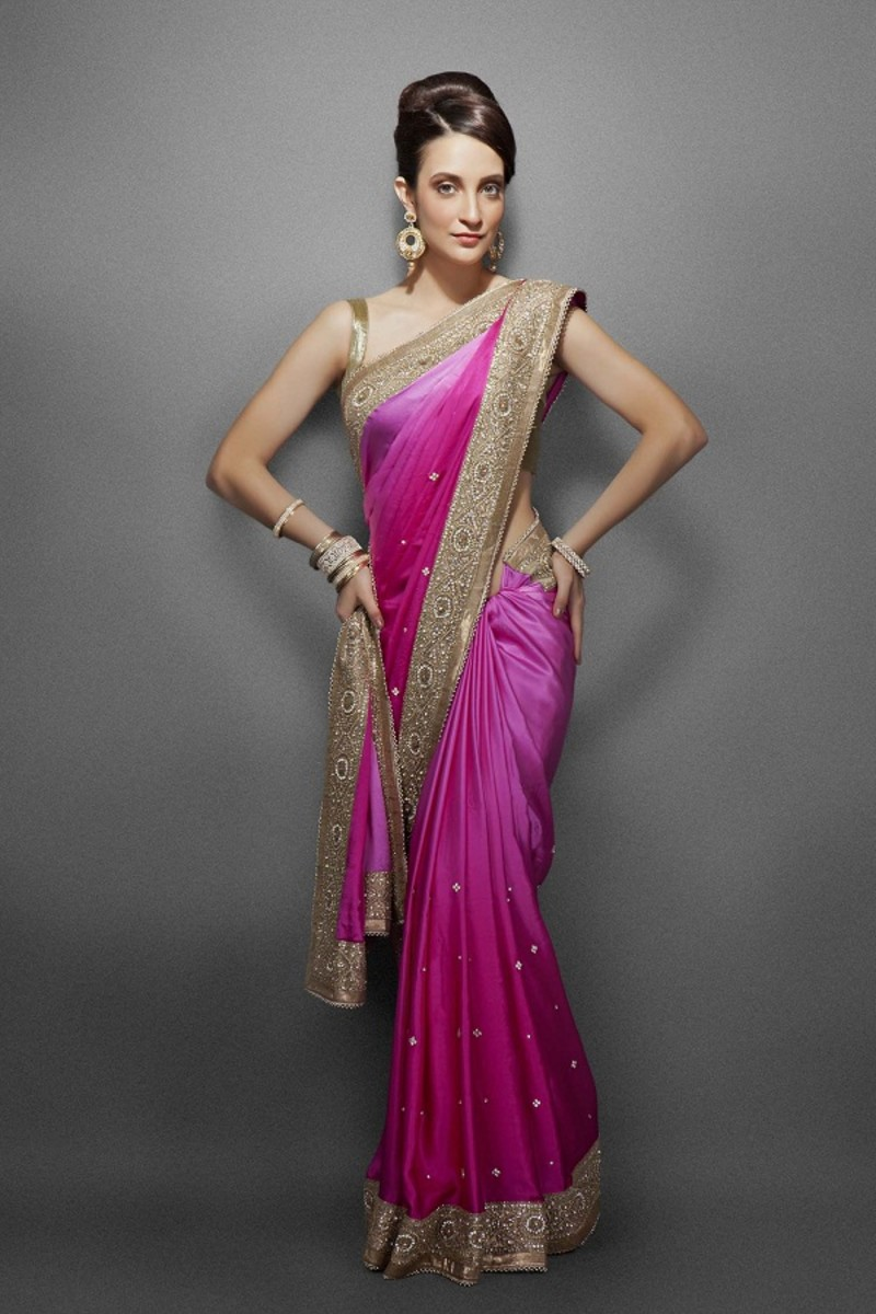 If the saree is to be worn nivi style and the pallu is pleated at the shoulder, it should be pleated narrow as shown in this picture.
