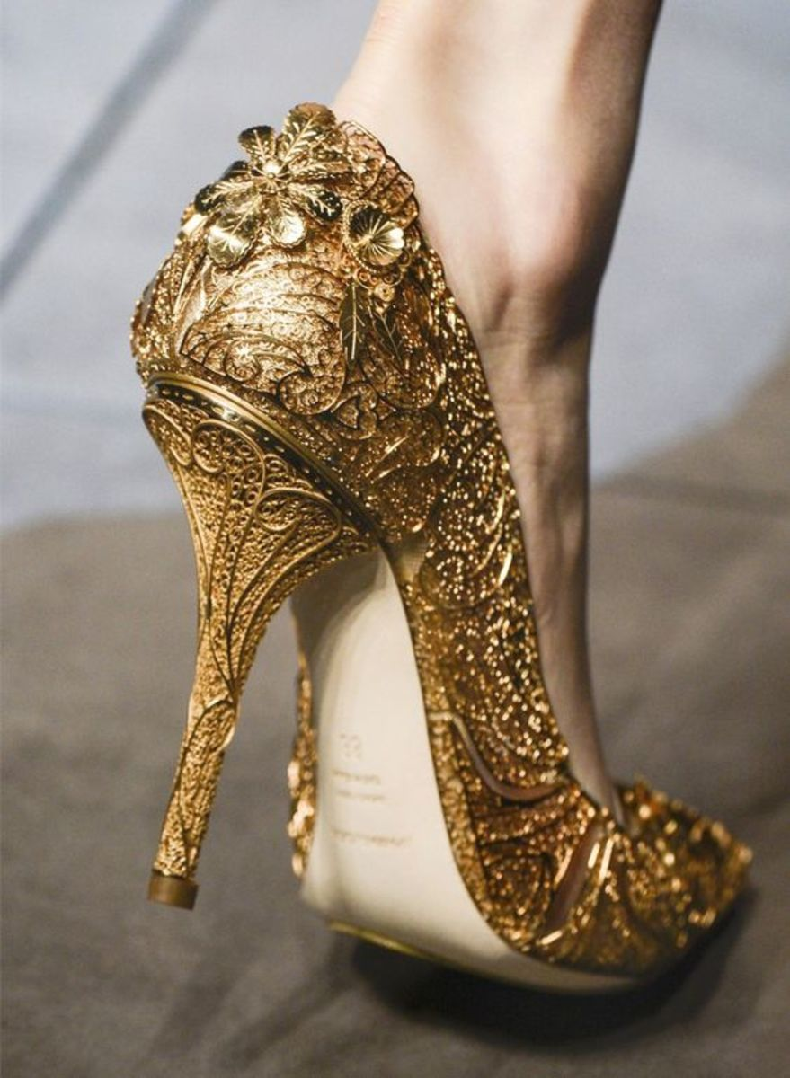 Gold pencil heel pumps