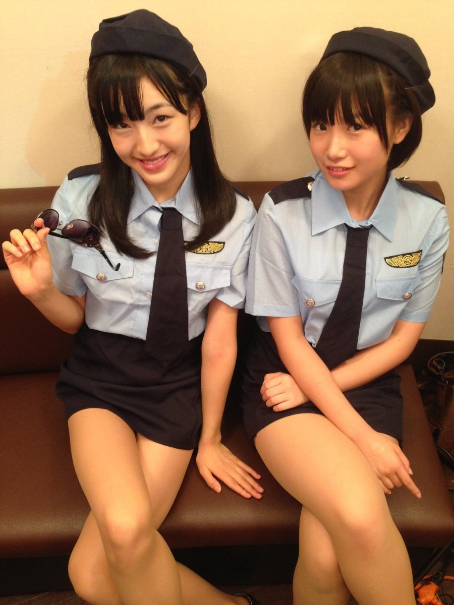 Meru Tashima (left) and Mio Tomonaga (right) look absolutely gorgeous in these police style uniforms!