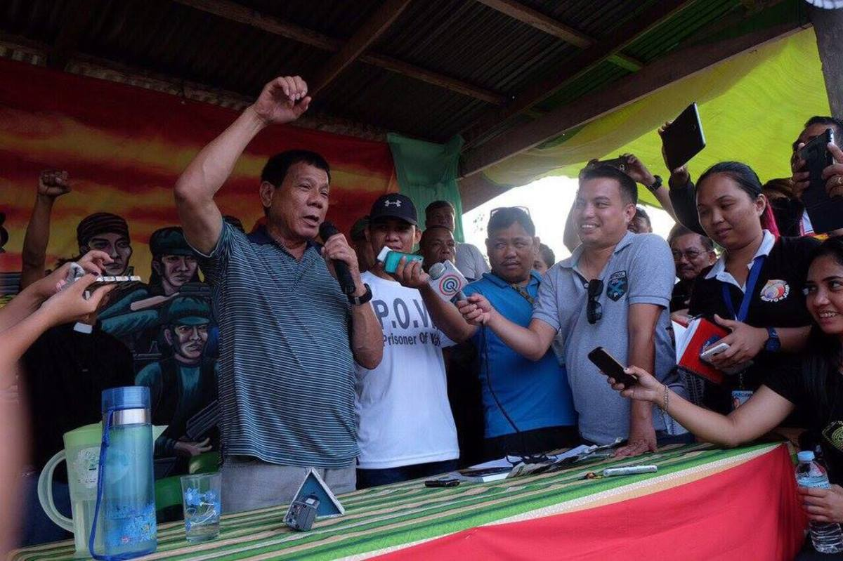 The New People's Army releases its captive Philippine National Police officers to then Mayor Rodrigo Duterte.