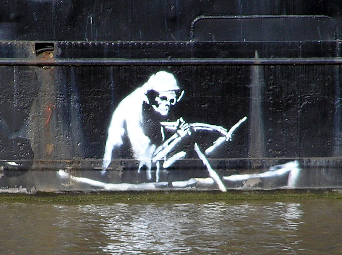 Banksy - Stencil on the waterline of The Thekla, an entertainment boat in central Bristol