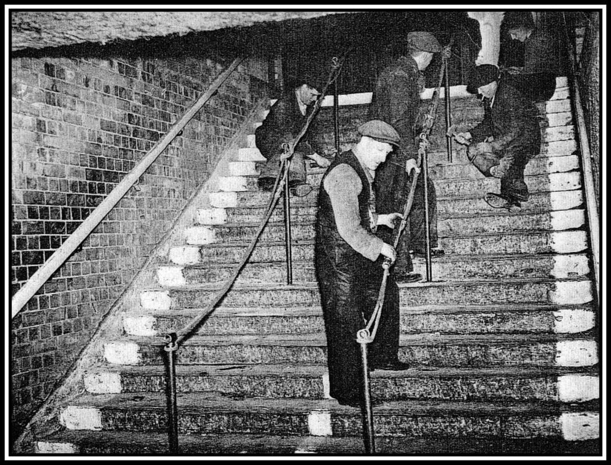 Workmen adding a temporary central handrail on the day following the Bethnal Green disaster