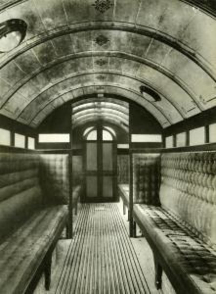 Interior of first enclosed carriage on early underground railway