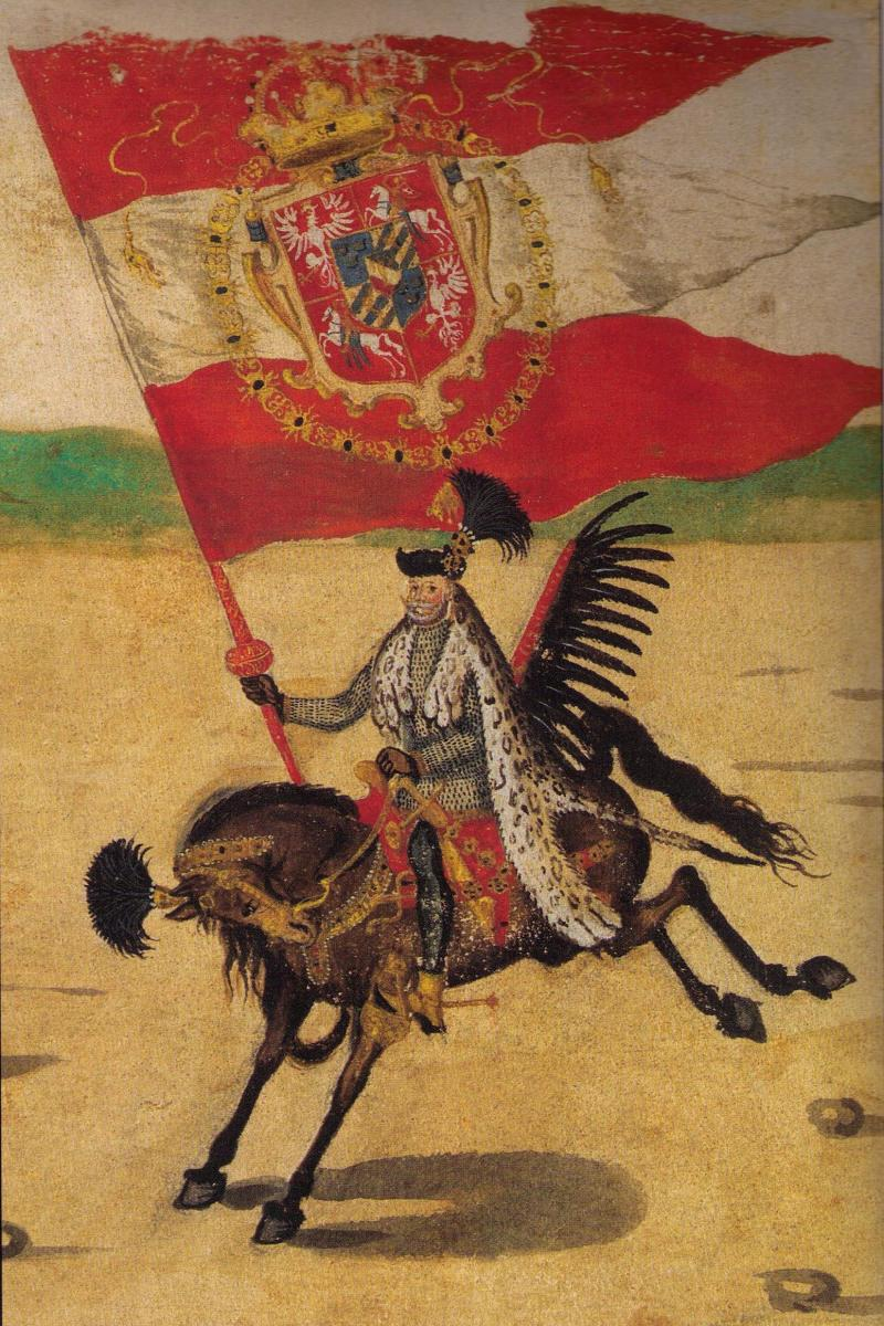 "A Polish ""Hussar"" with a crest on his helmet as well as the horse."