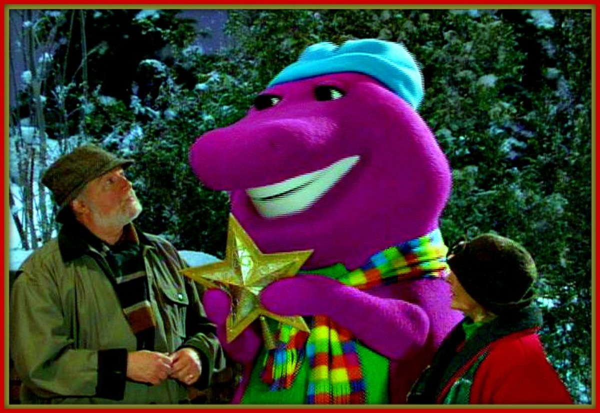Barney's Christmas Star, 2002, sends Barney and his friends on a mission to find the perfect Christmas star for the top of the tree! Barney and his friends in the holiday spirit, they trim the Christmas tree in the snow covered park.