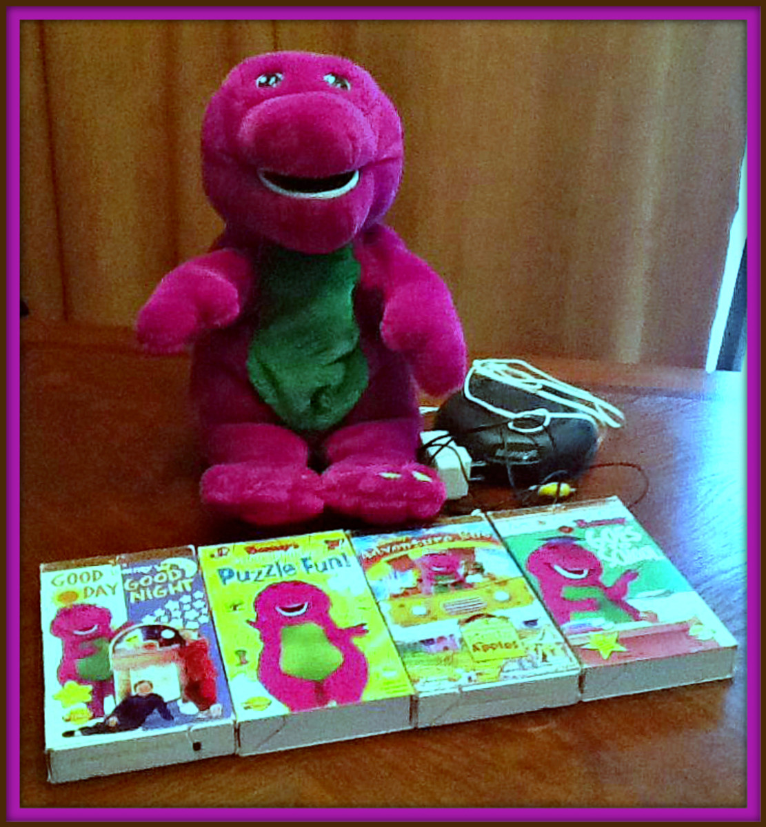 The first is the talking and moving plush ActiMates Interactive plush Barney companion. The next is a TV Pack which is equipped with a RF transmitter that plugs into the VCR and operates specially encoded Barney VHS videotape.