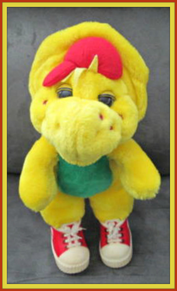 Here is a vintage 1994 Barney Character B. J. Plush 13 inches stuffed yellow dinosaur with  his famous vinyl sneakers.