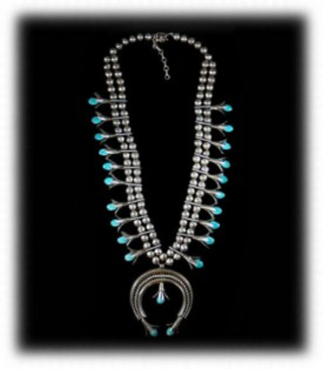 Vintage Navajo Squash Blossom necklace made between 1940-1960.  Made with sterling silver.  This is also a classic style that is still made today and very popular.