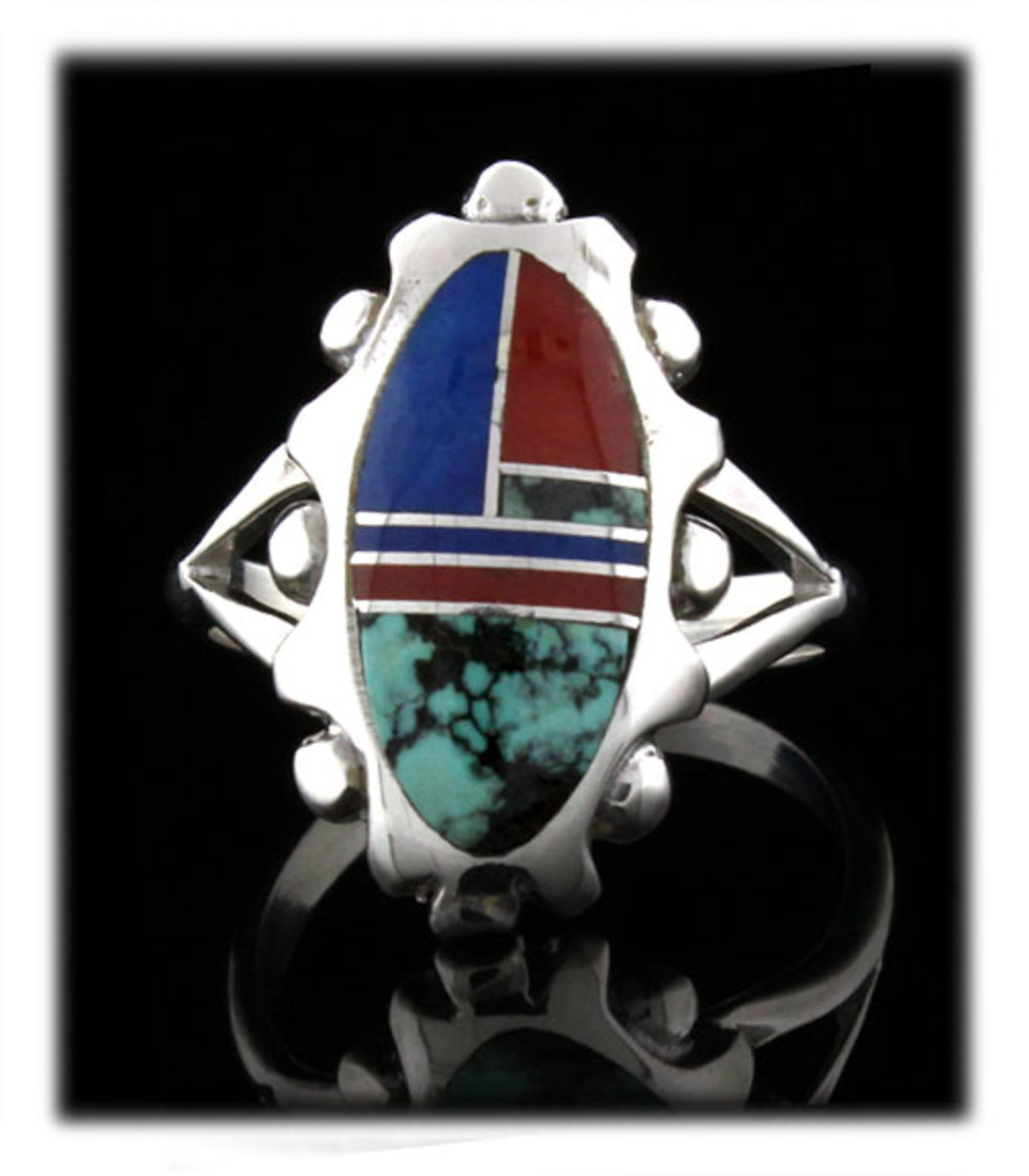 Silver, turquoise, lapis and coral inlay ring crafted by Stanley Manygoats here in New Mexico.