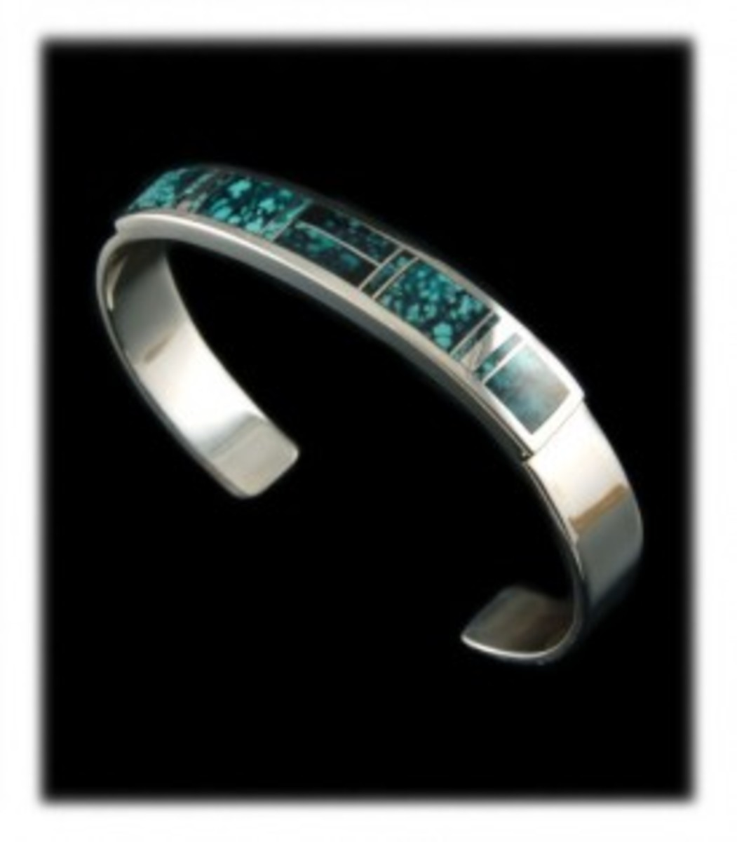 Turquoise and silver inlay cuff bracelet made by Navajo Native American Stanley Manygoats of New Mexico.