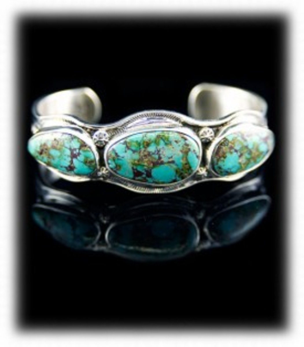 Bisbee Turquoise Bracelet.  Three bezel turquoise stones soldered on top of a silver stamped bracelet frame.  Named Bisbee for the Bisbee turquoise mine in Arizona.