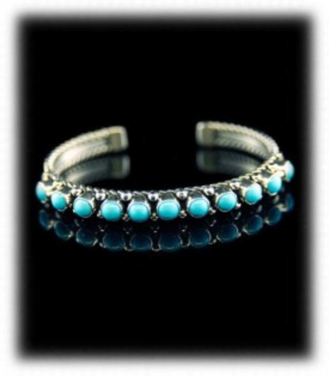 Navajo Turquoise Row Bracelet.  Turquoise from Sleeping Beauty mine in Arizona. (Mine closed in 2012)  Very classic bracelet made for decades.