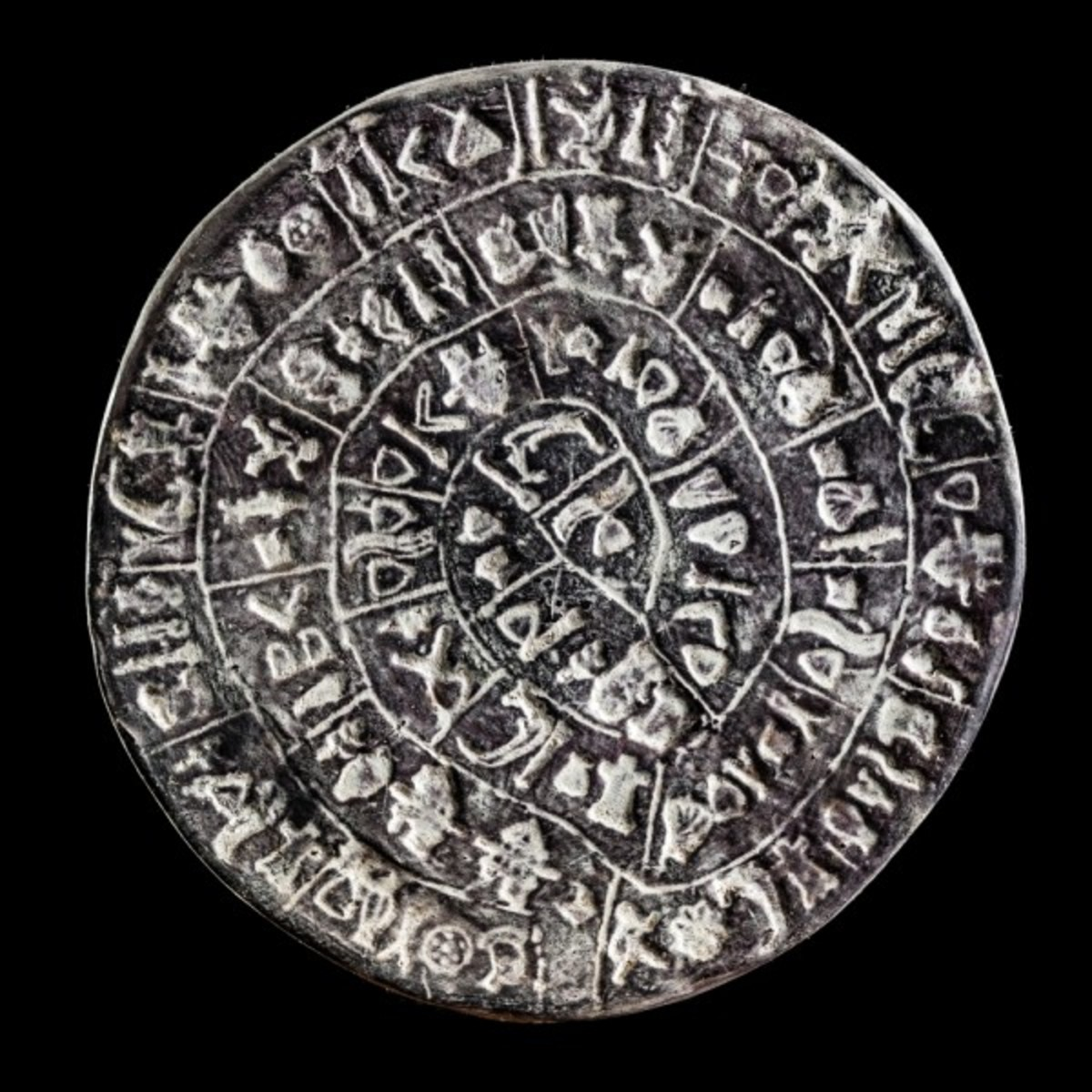 The Phaistos Disc was discovered by the Italian archeologist Luigi Pernier in 1908, near the Minoan palace of Phaistos. The disc is believed to have its origins from the late Minoan Bronze Age. It is 15 cm wide.