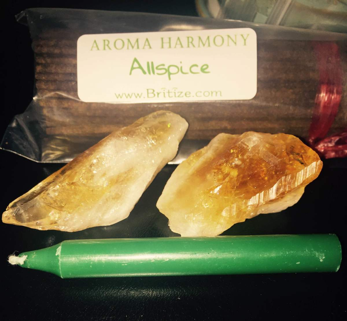 Raw citrine crystals, green candle and Allspice Incense.