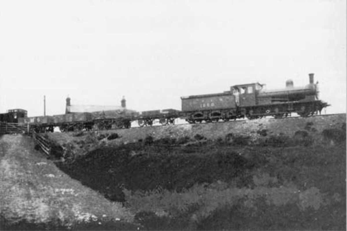 At Blowath Crossing ('Blue Ford', the water reflected the clear sky, named during a moment of quiet reflection in summer no doubt) Class J24 climbs wih a short rake of mixed open wagons. Vans would not pass under the cable drum.