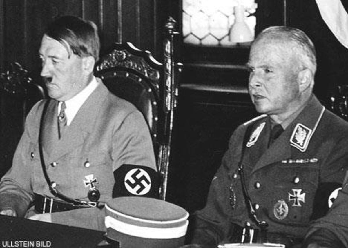 Hitler sitting with the filthy traitor Duke of Saxe-Coburg, formerly Prince Charles Edward, a grandson of Queen Victoria and a close friend of the Duke of Windsor, had willingly embraced Nazism and murdered thousand of disabled prisoners.