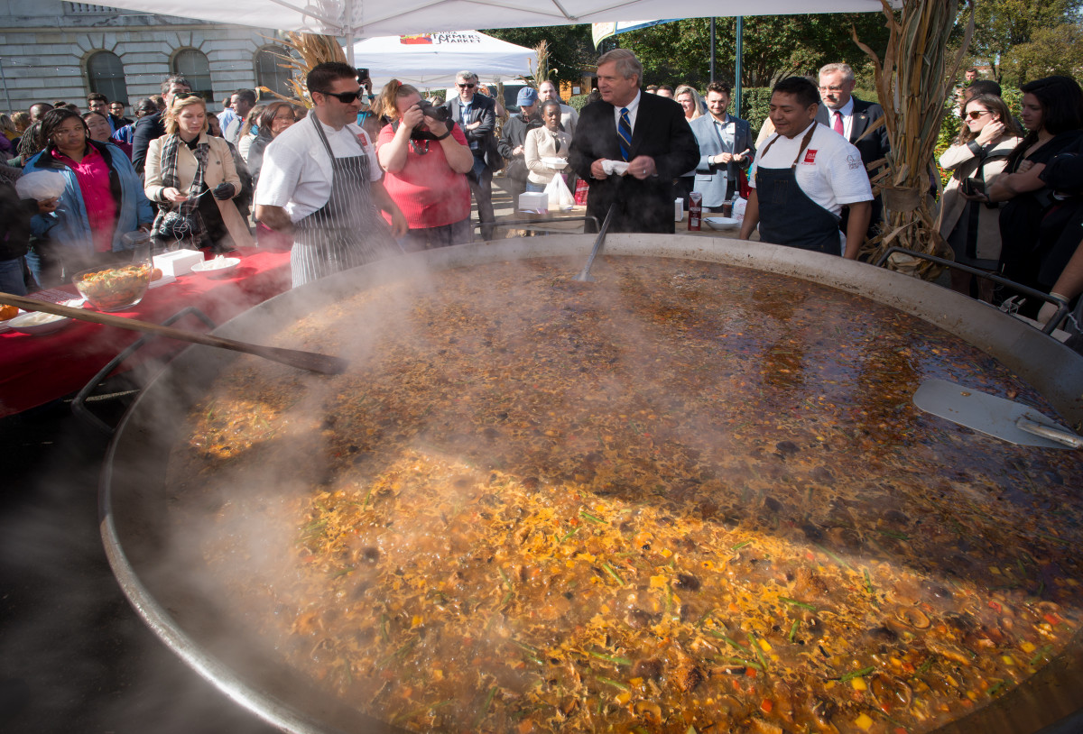 Paella cooking outdoors in a seven-foot pan.