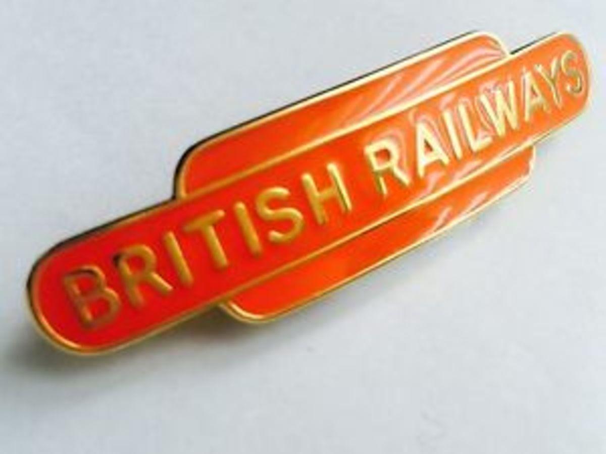 British Railways tangerine coloured cap badge, a period keepsake