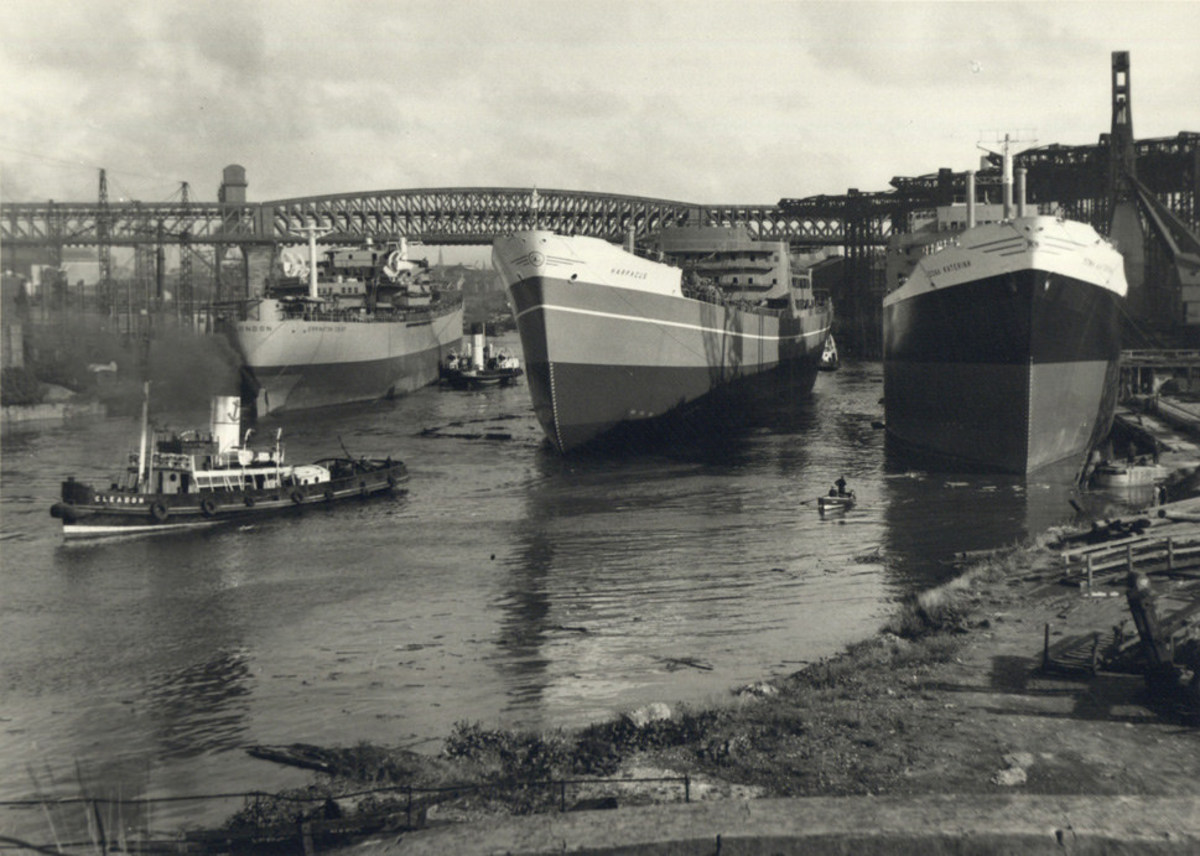 Three Sunderland-built ships await fitting-out after launch on the River Wear
