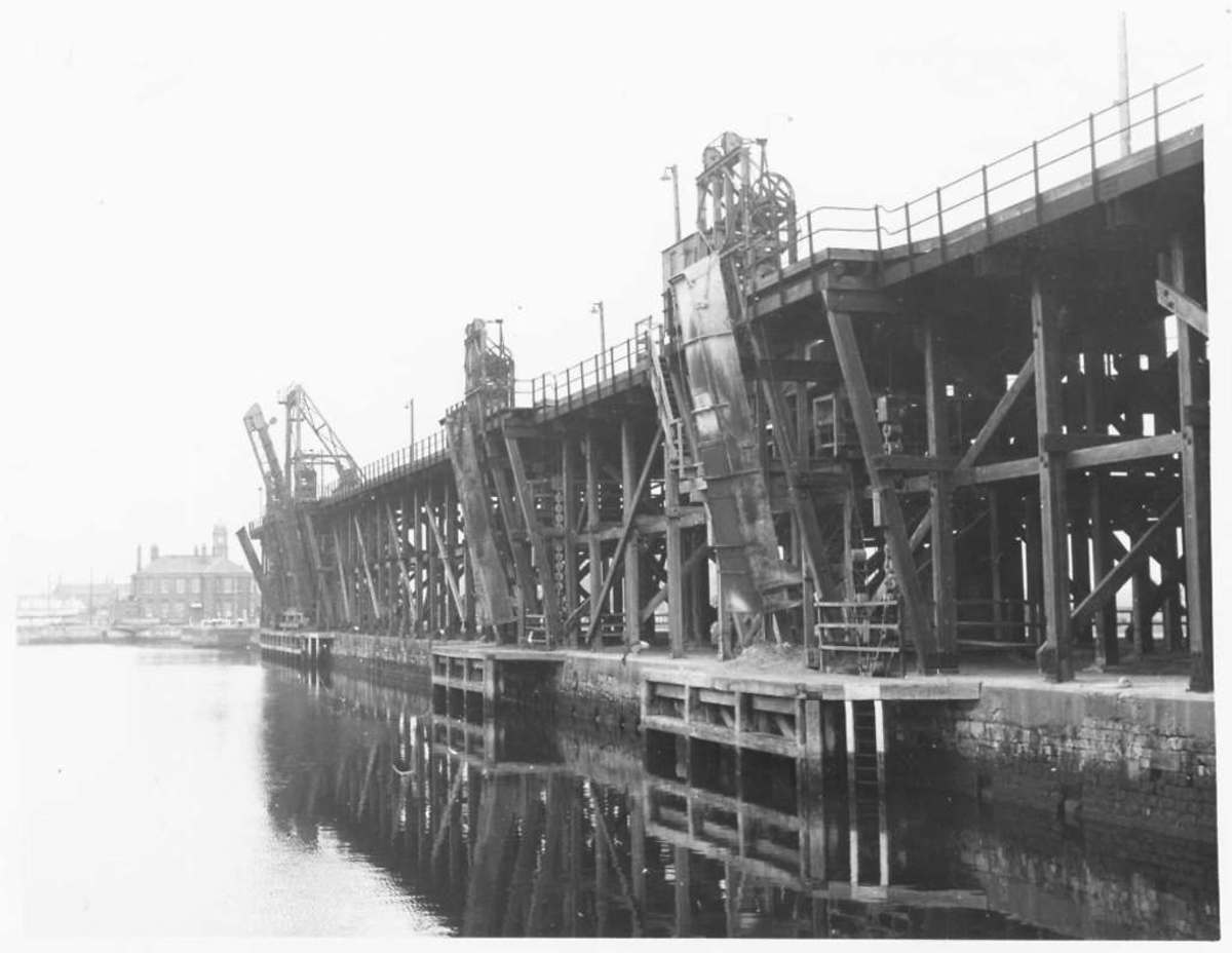 The coal staiths at Hartlepool - gravity unloading into ships from as far off as the Baltic was facilitated by hoppers under the rail deck. Behind is the Dock Master's Office
