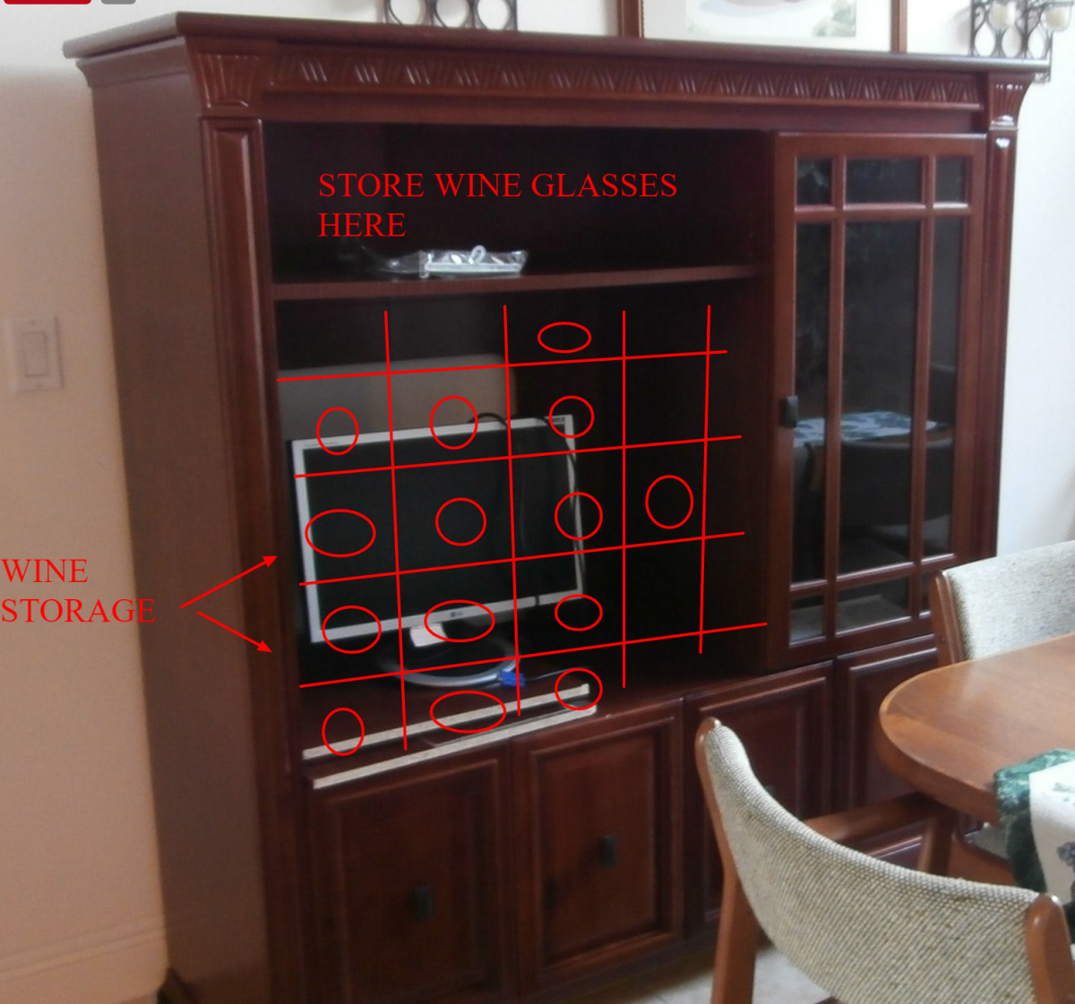 Get an insert to covert the large opening into a wine rack or if you do woodworking, make that yourself.
