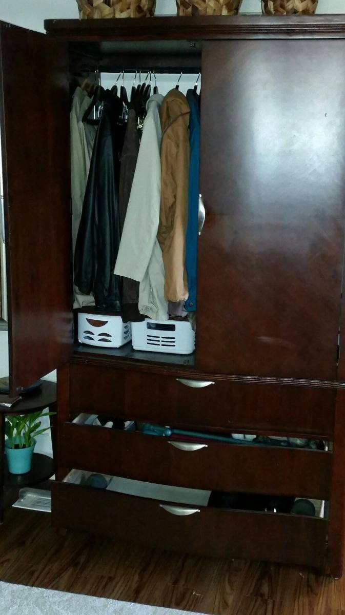 Add a clothes rod to the largest section of the unit. You can store mittens, mufflers and hats in the drawers. In this one, they keep exercise gear in the drawers.
