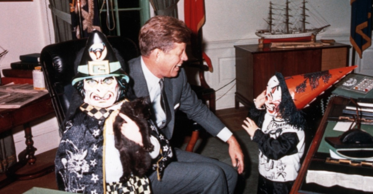Former President John F. Kennedy with his children, John Jr. and Caroline at the White House.  Everyone loves Halloween.