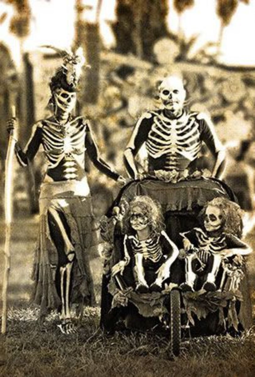 "This is ""Mr.. Skelly Ton and the whole Ton family,"" decked out for Halloween in some pretty great costumes."