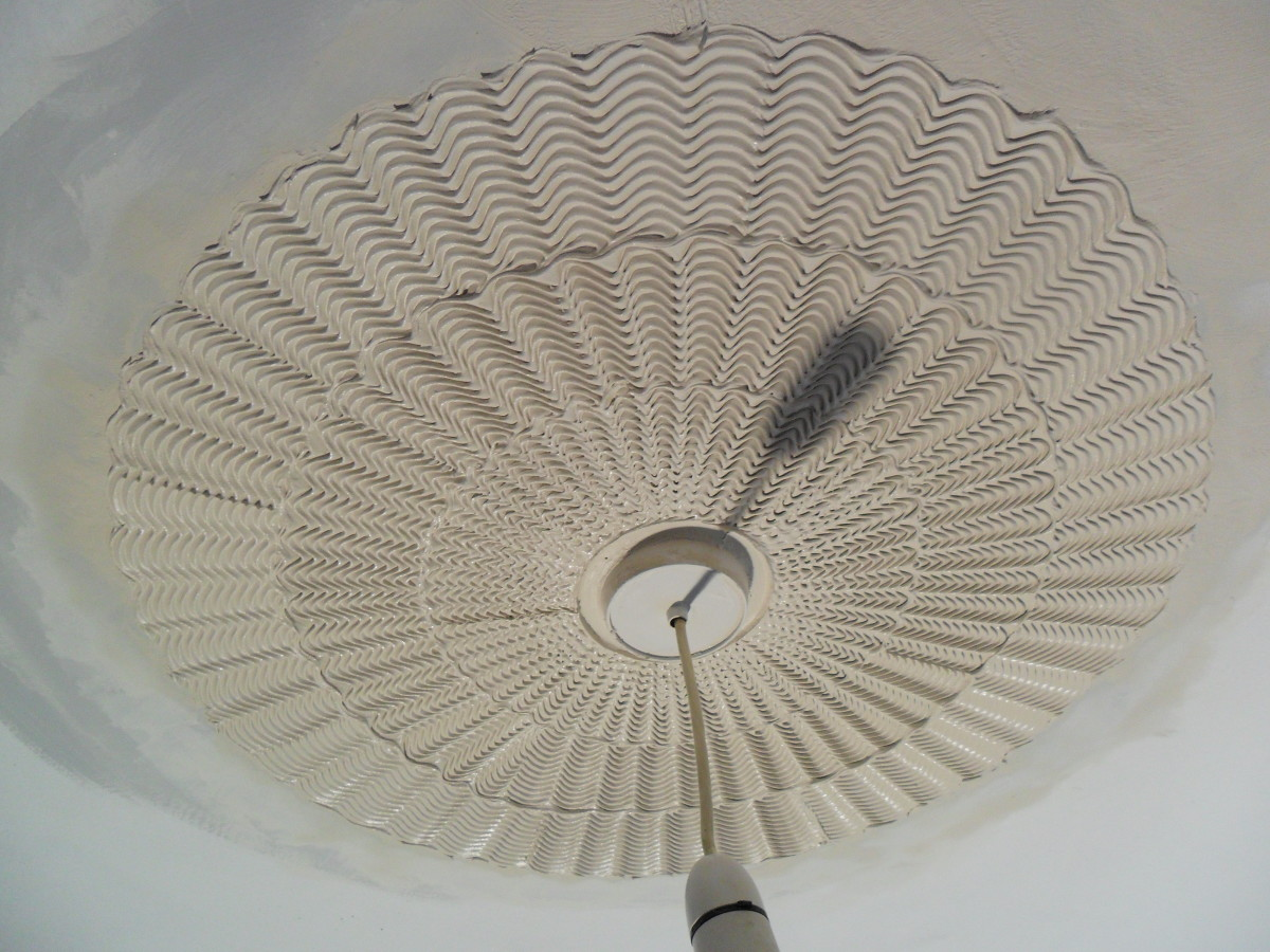 The Standard comb effect creates depth, and each comb overlaps the pattern just created as one works inwards, towards the center fitting, finally running a finger around the interior perimeter to clean off residue