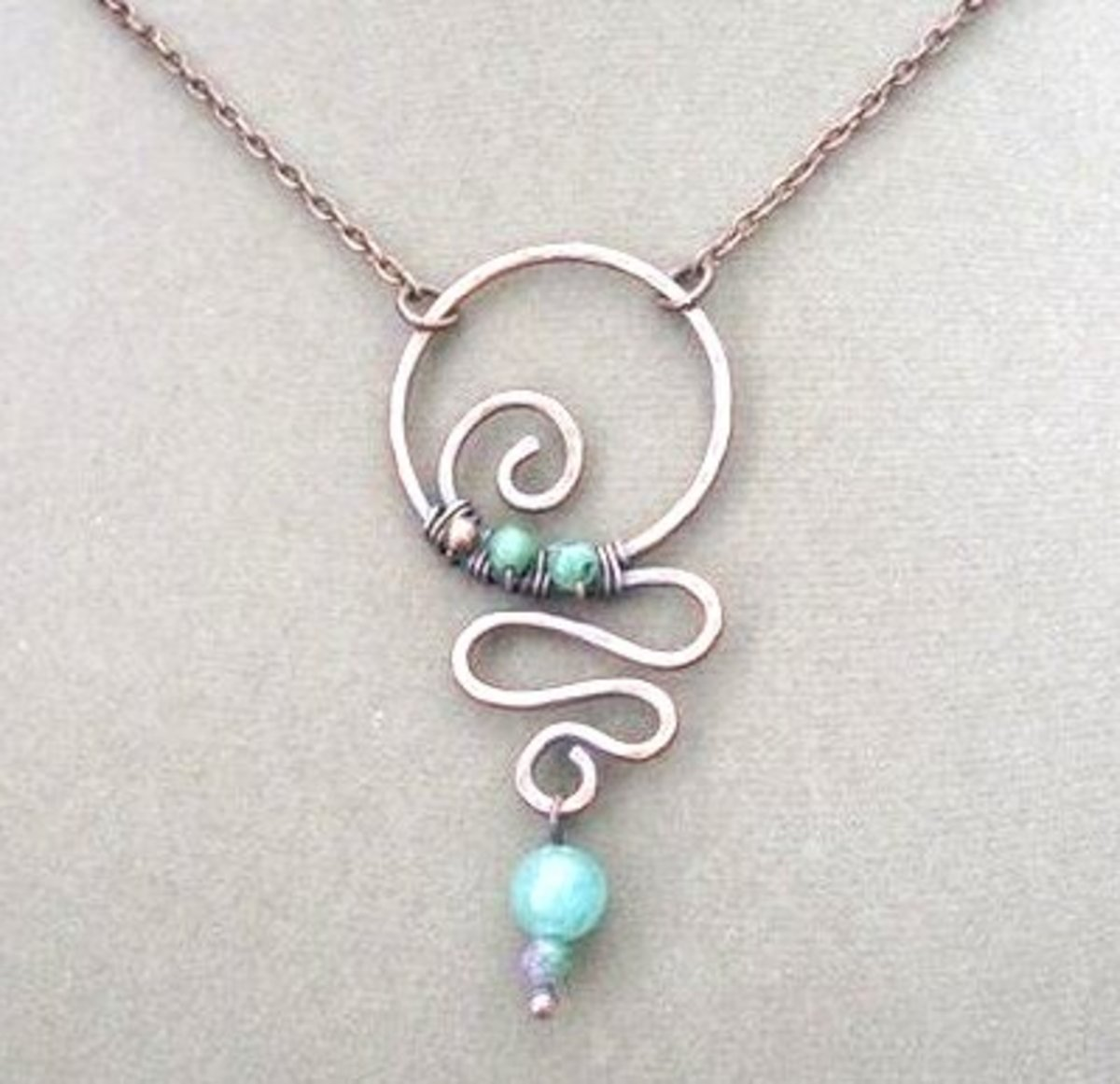 This necklace is a little more advanced, but in my opinion, once you learn how to work with wire, it would be fairly simple to make with the right supplies