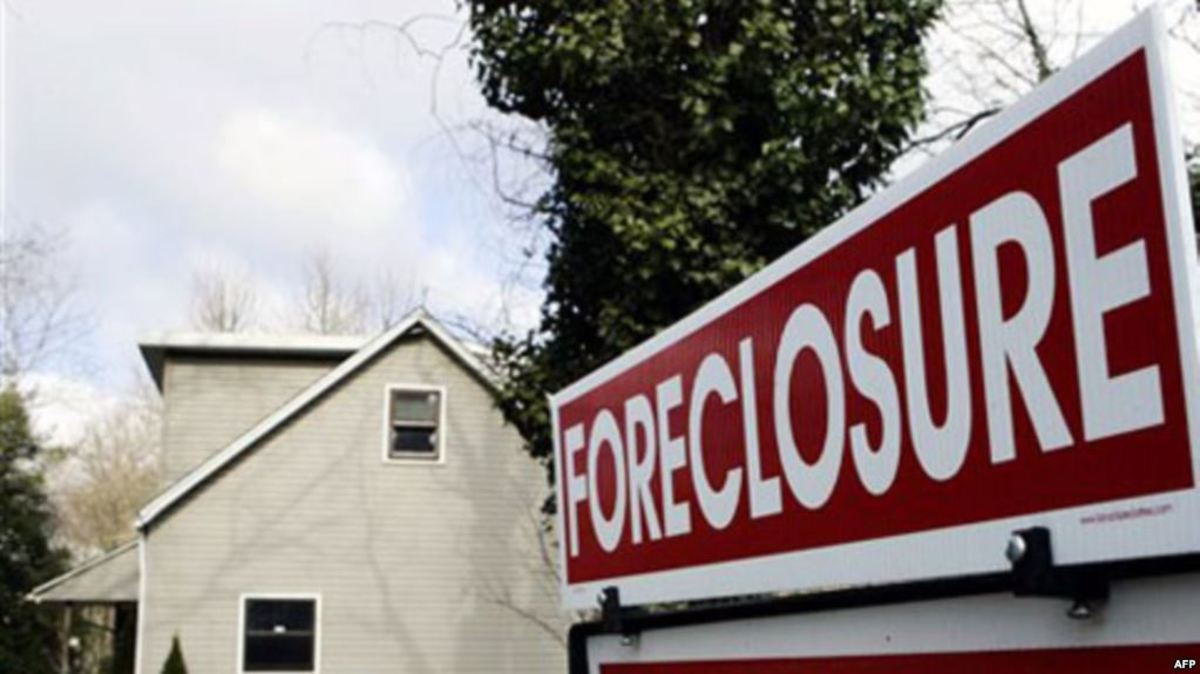 A sign on the lawn of a foreclosed New Jersey home in 2008.