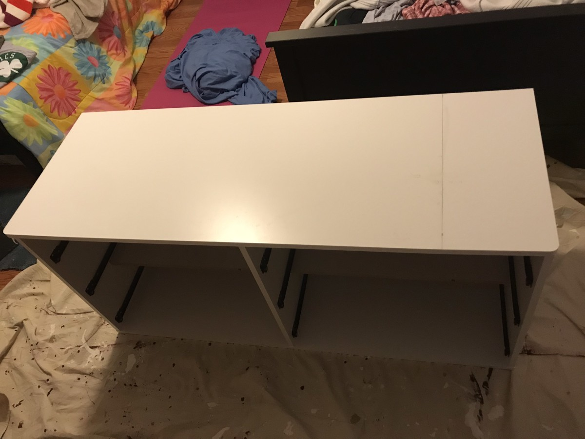 Mark the new length.  It is the pencil line drawn on the top of the dresser.
