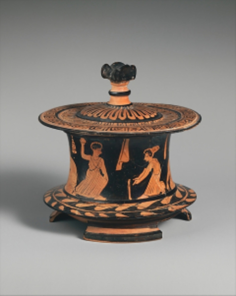 """Terracotta pyxis (box)."" 425-400 BCE. Held by the Metropolitan Museum of Art."