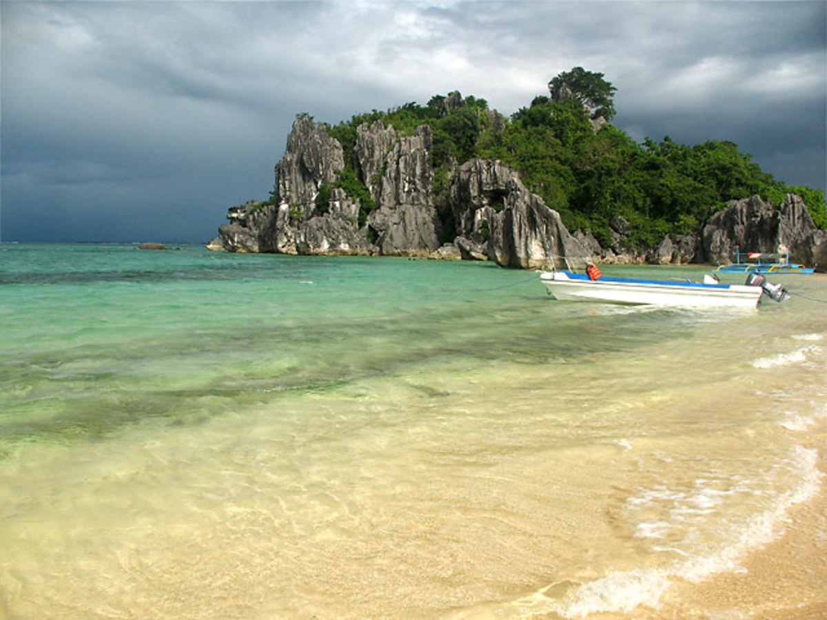 Sabitang-laya is a triangular shaped island in the Caramoan peninsula and is different from the other islands as it has twin beaches...