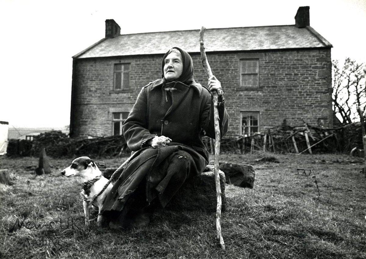Hannah and companion take a short rest outside the farmhouse