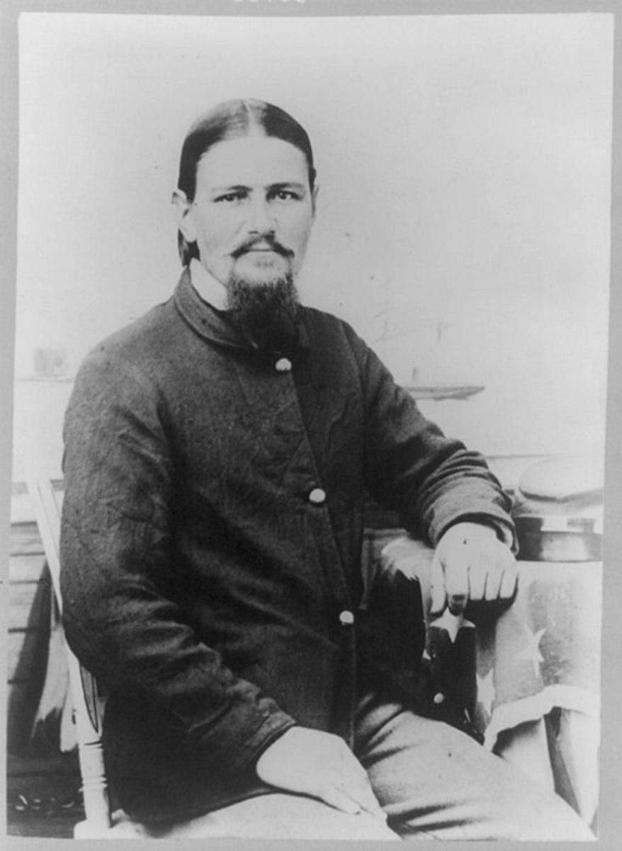 Boston Corbett, half-length portrait, seated 1865