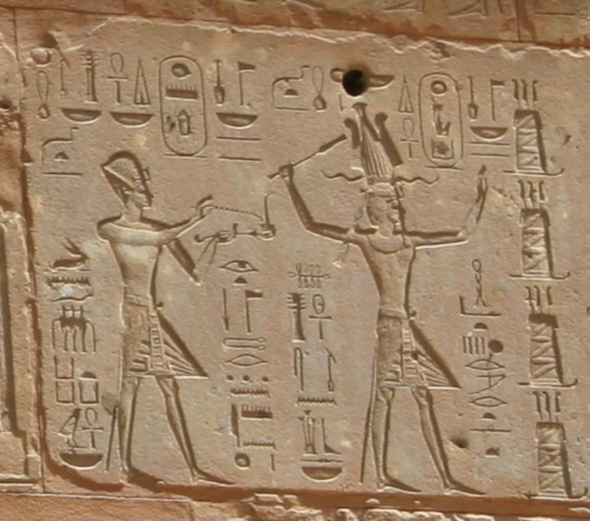 Hieroglyphs showing Thutmose III on the left and Hatshepsut on the right, she having the trappings of the greater role — Red Chapel, Karnak.