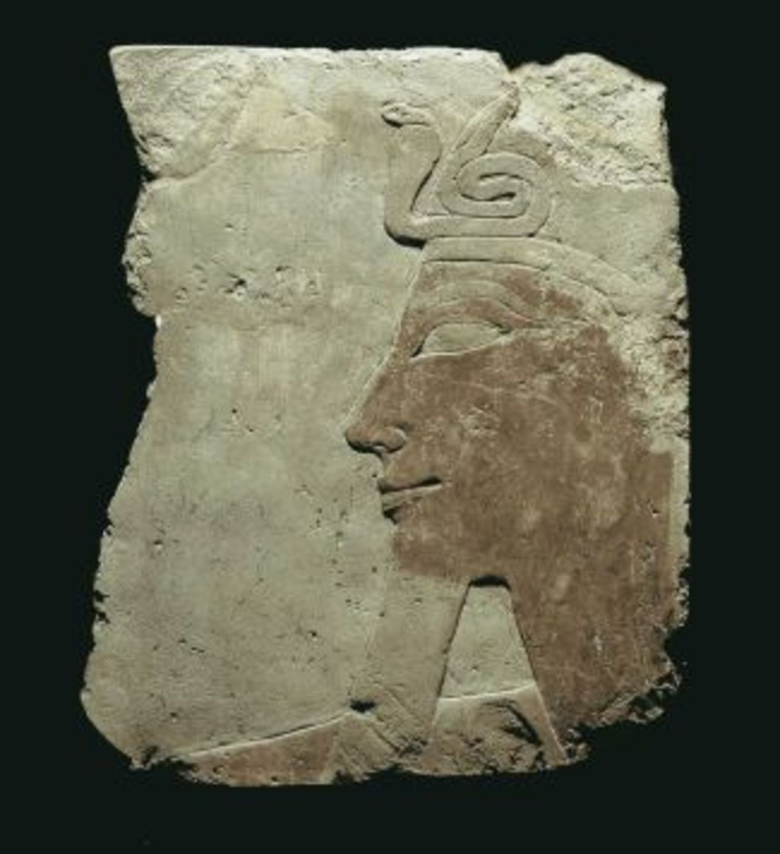 Fragment, limestone raised relief of Queen  Hatshepsut from her mortuary temple.